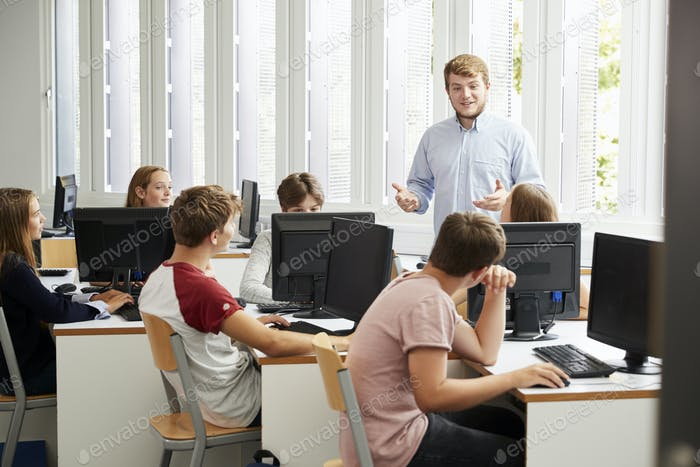 Teenage Students Studying In IT Class With Teacher