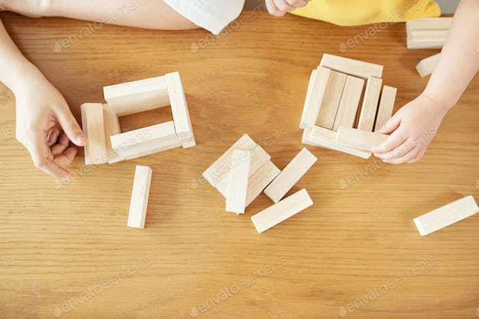 Playing with wooden toys