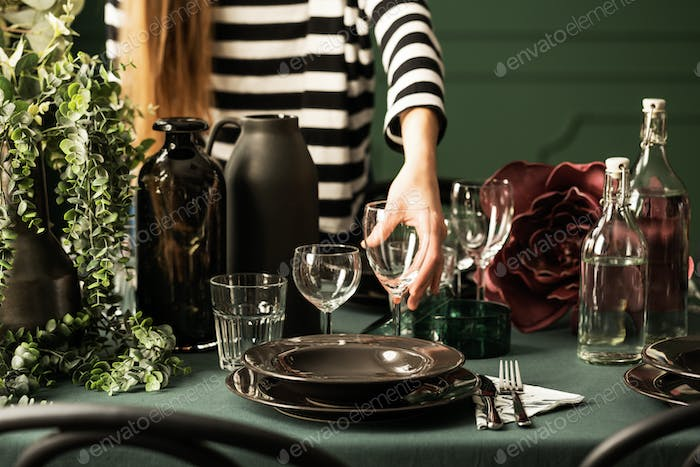 Closeup of housewife preparing table for christmas dinner