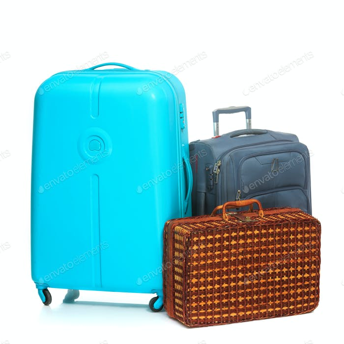 The modern and retro suitcases on white background