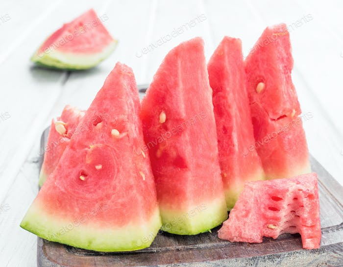 lots of watermelon on white wooden board