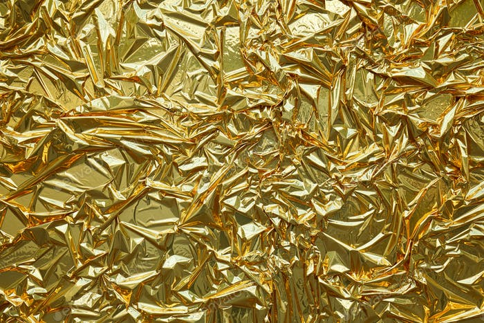 Golden metallic foil texture background
