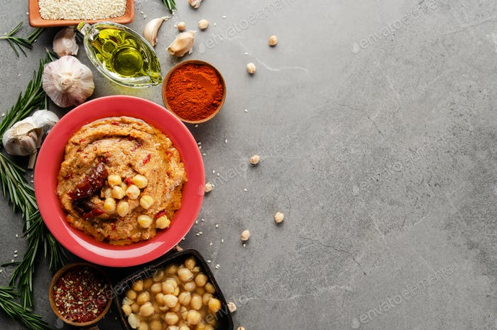Hummus topped with chickpeas, olive oil