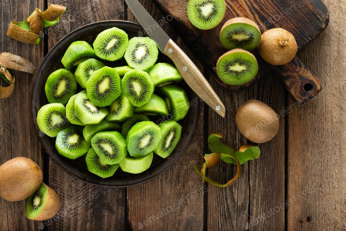 Kiwi fruit on wooden rustic table, ingredient for detox smoothie