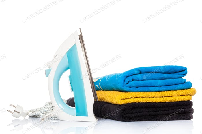 Thumbnail for iron and clothes.  Steam iron and colored towels isolated on whi