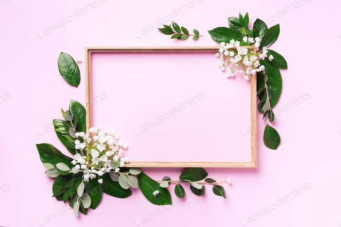 Creative layout with white flowers and copyspace over pink background. Top view, flat lay. Spring