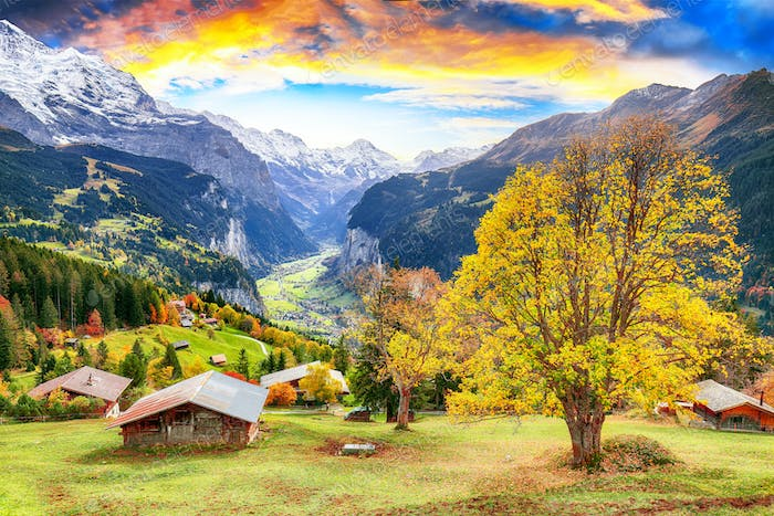 Fabulous autumn view of picturesque alpine Wengen village and Lauterbrunnen Valley
