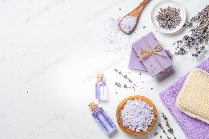 Lavender cosmetics on white top view