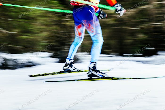 blurred image legs men skier