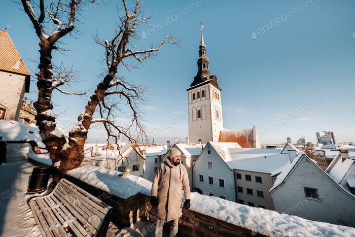male tourist outdoors in winter in the old town of Tallinn.Estonia