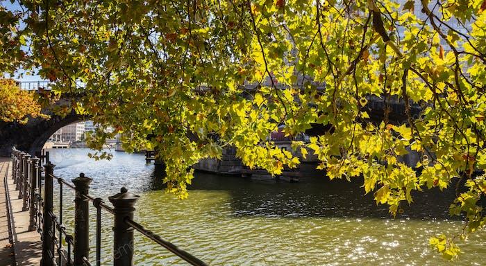 Sidewalk By Spree River On A Sunny Day In Berlin Germany