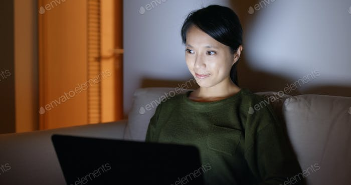 Young Woman work on laptop computer at home