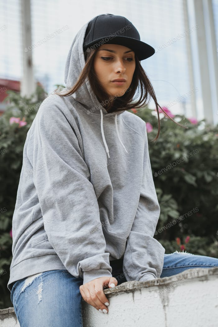 Young girl wearing hoodie