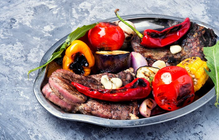 Grill meat and vegetables
