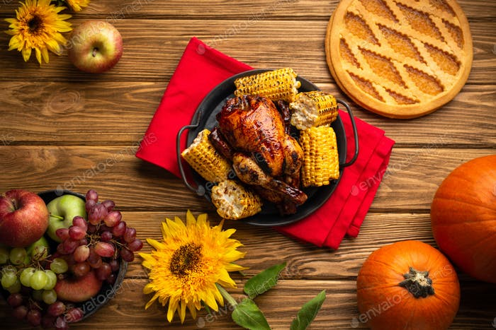 Thanksgiving festive table composition with roasted turkey, pumpkin pie, autumn fruit