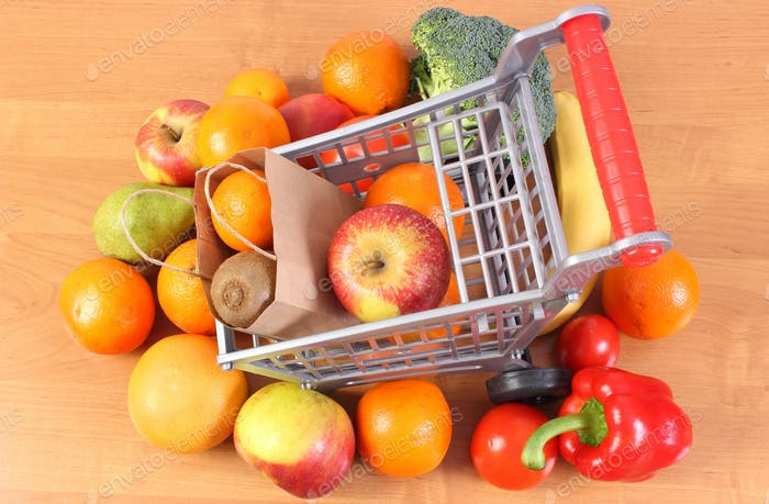 Paper shopping bag and fruits with vegetables