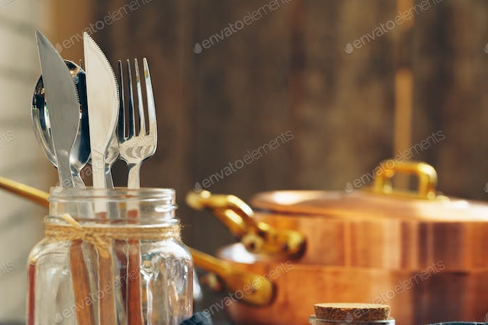 Clean copper cookware in kitchen close up