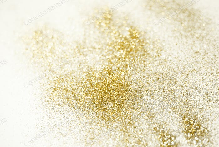Golden glitter shiny glowing background. Gold festive bokeh card for holidays.