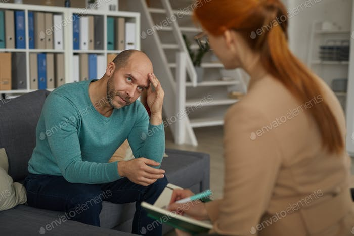 Man sitting at psychology therapy