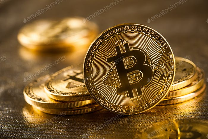 Gold bitcoins on glittering background, close up
