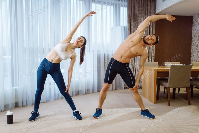 Morning aerobic workout of love couple at home