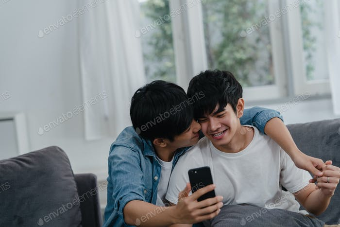 Asian influencer Gay couple vlog at home, using technology mobile phone record lifestyle vlog