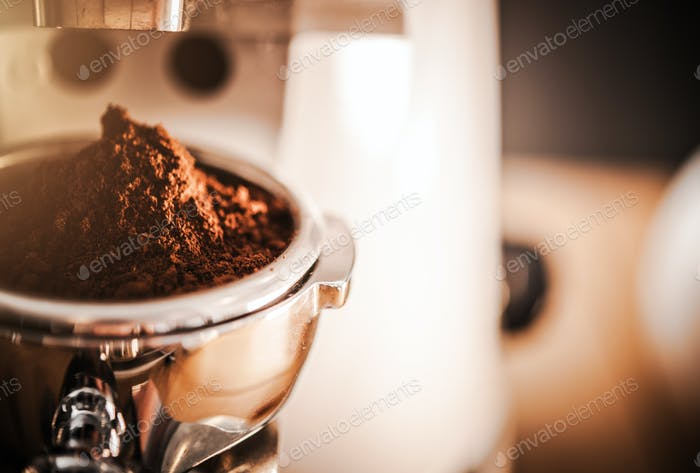 Close Up Of Coffee Grinder And Scoop Of Coffee.