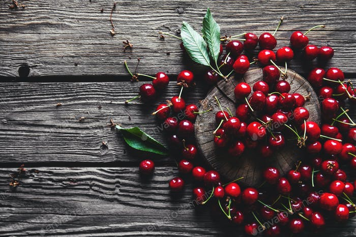 sweet cherry on a wooden background, healthy food, fruit