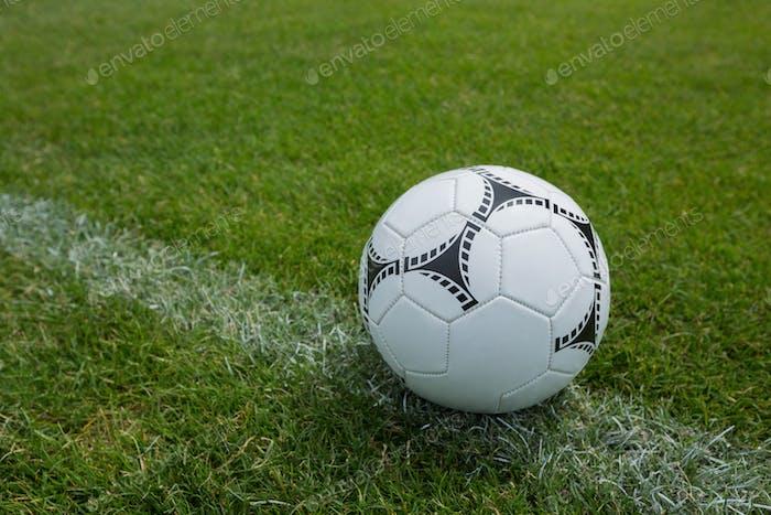 Soccer ball on white marking line