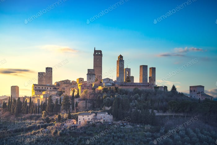 San Gimignano town skyline and medieval towers sunset. Tuscany,