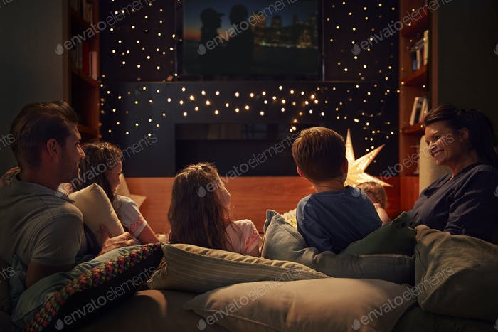 Thumbnail for Family Enjoying Movie Night At Home Together