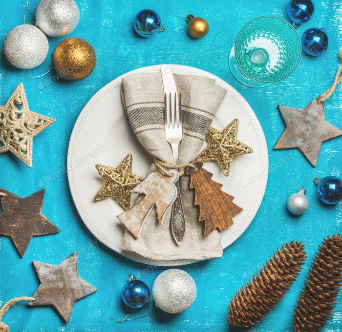 Christmas, New Year holiday table setting over bright blue background