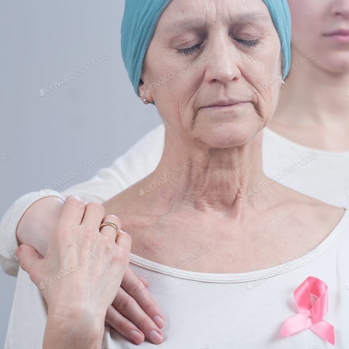 Cancer woman with pink ribbon