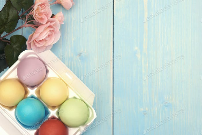 Easter eggs on the blue wood