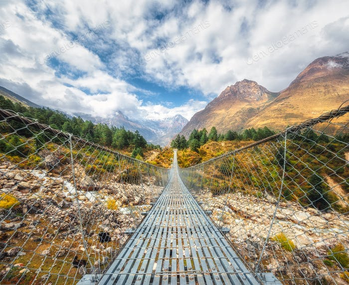 Suspension bridge and beautiful himalayan mountains