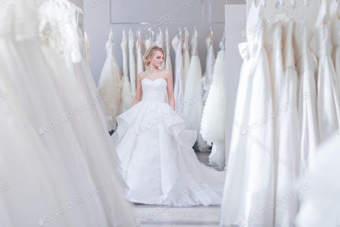 Beautiful woman in wedding shop