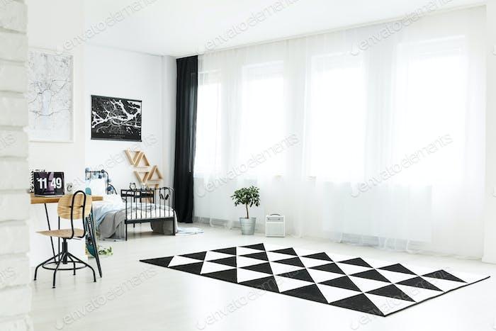 White spacious boy's bedroom