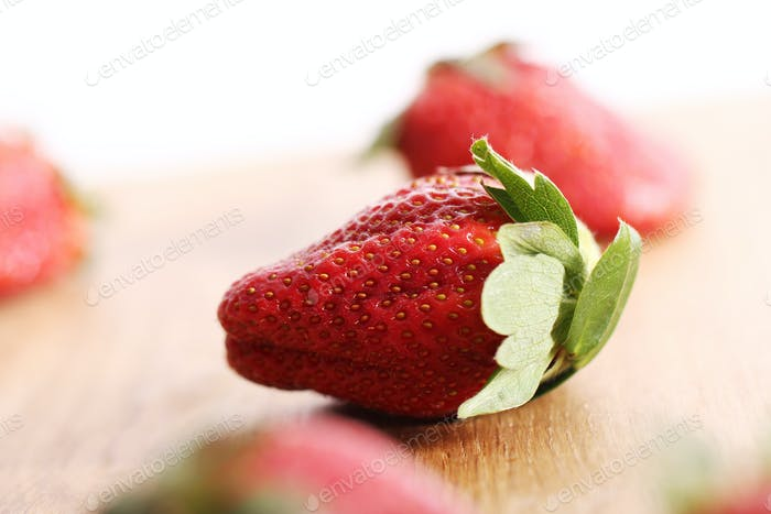 Strawberries on wooden surface
