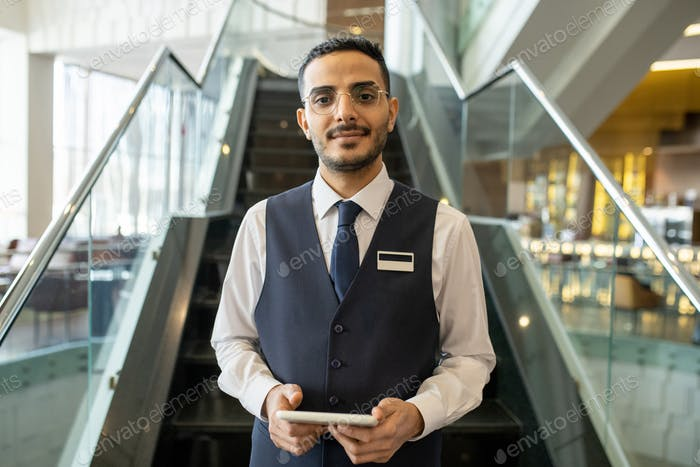 Young hotel manager with tablet