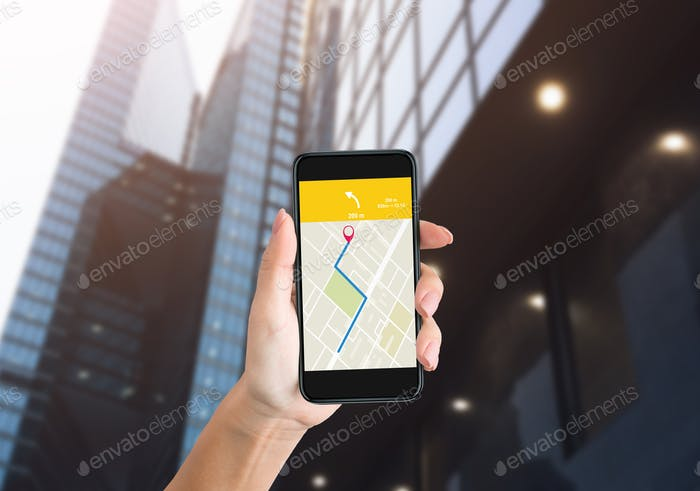 Female Hand Holding Phone With GPS Navigator Application Outdoors