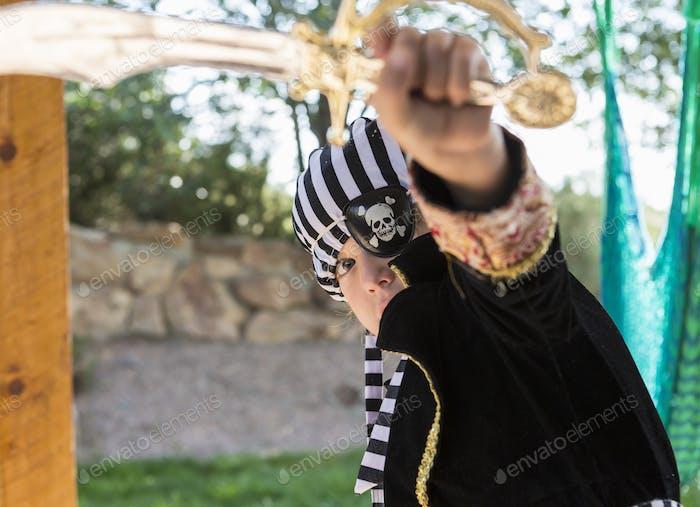 5 year old boy wearing pirate costume