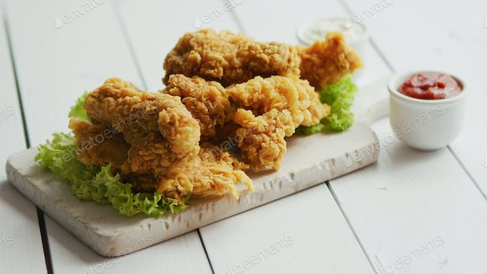 Fried meat laid on chopping board