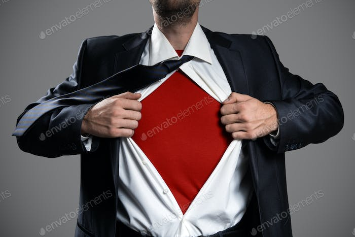 Businessman Acting Like A Super Hero And Tearing His Shirt.