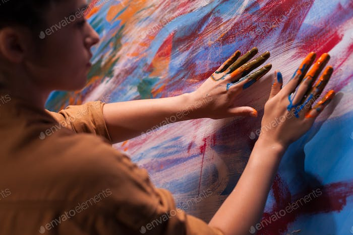 Woman painting with fingers