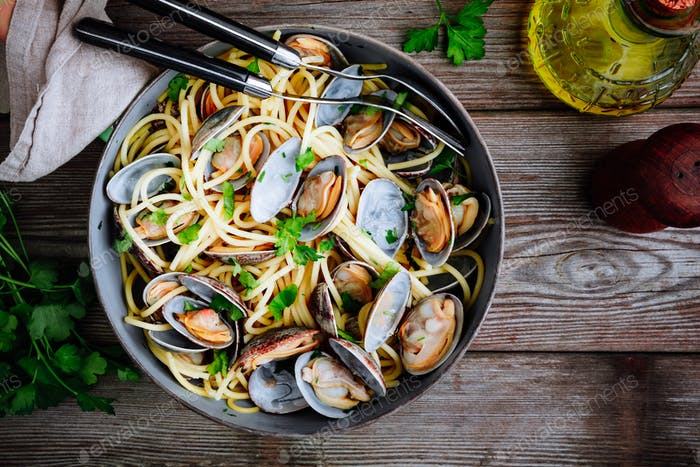 Traditional italian seafood pasta with clams Spaghetti alle Vongole in the pan