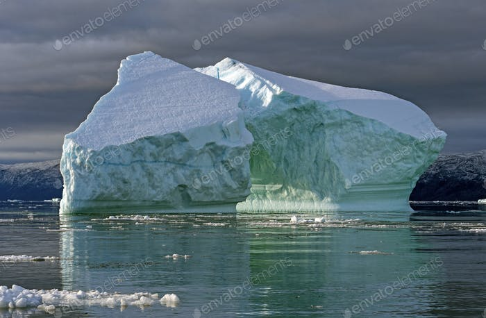 Large Icebergs in Clouds and Sun