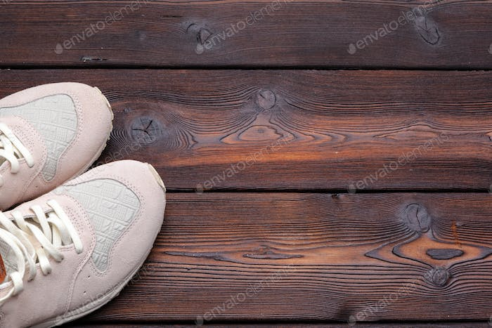 sneakers on old retro wooden background. Close up.