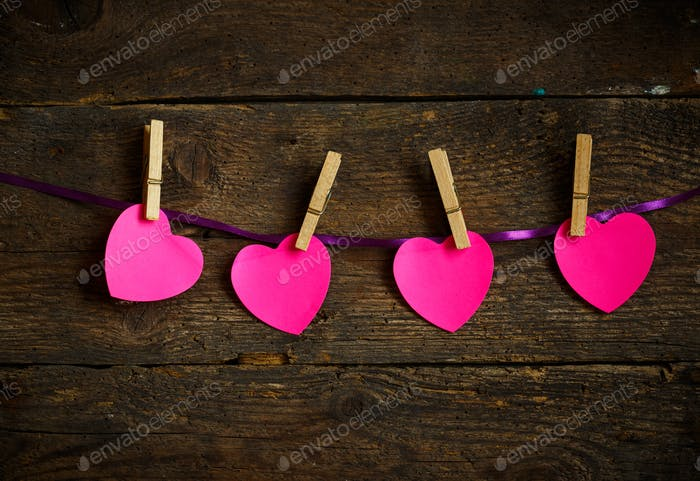Pink heart paper cut out with clothes pins