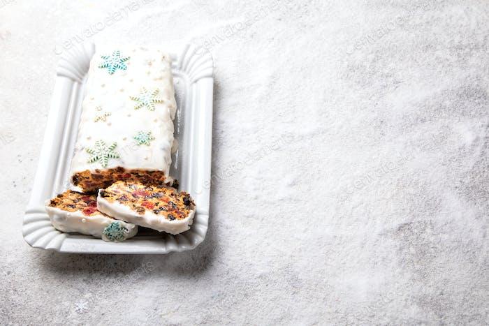 Christmas Fruit Cake, Pudding on snowy background . New Year pas