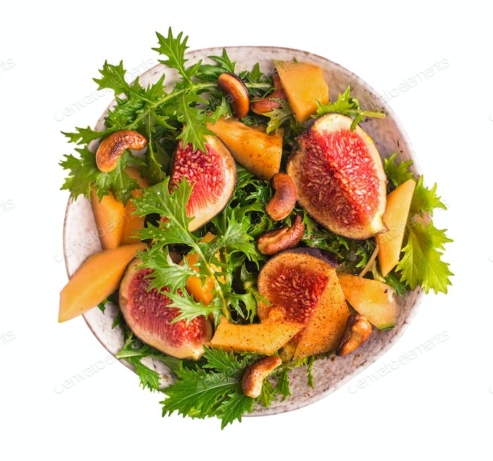 Fig and melon salad with mizuna isolated